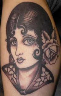 Old school pin up girl black ink tattoo