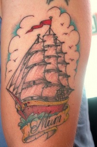 Big colored old school ship tattoo with inscription